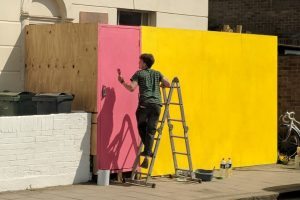 Painting the construction hoarding